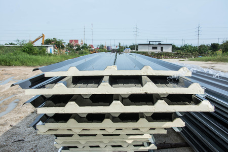 attached: black metal sheet  roof with insulation attached under metal sheet.