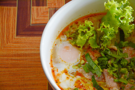 noodle tom yam with  soft boiled egg