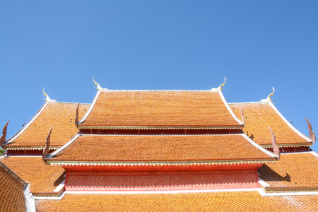 red temple roof with blue sky Stock Photo
