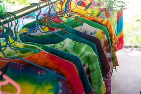 colorful clothes on  hangers in market Stock Photo
