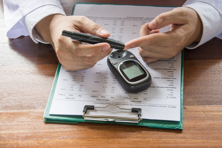 Man Hands Testing High Blood Sugar With Glucometer