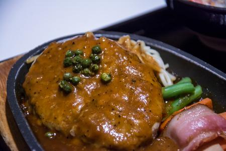fire pork with mushroom and sausage on hot pan.japanese food