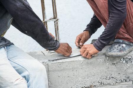 construction workers steel tie