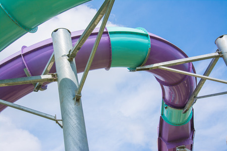 water slide with blue sky in water park