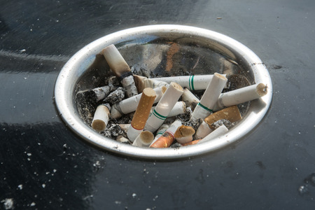 heap of many cigarettes stubs, cigarette butts in ashtray
