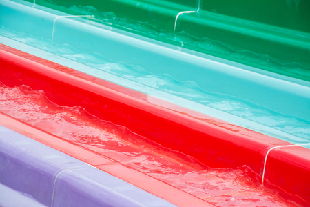 colorful plastic water-slide in swimming pool