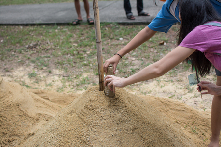 Prachin Buri, Thailand - April 14, 2018:  Thai people come to build the Sand Pagoda for return the sand to the temple on Songran festival at Pho temple  Archivio Fotografico - 100723061