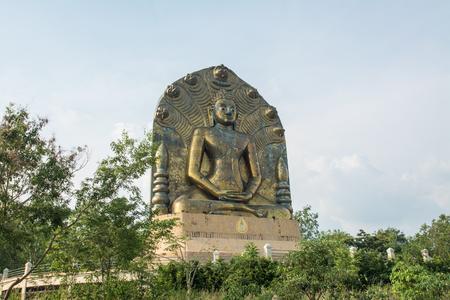 The Great Buddha statue at khao ito, Ban phra Prachin Buri Archivio Fotografico - 100752949