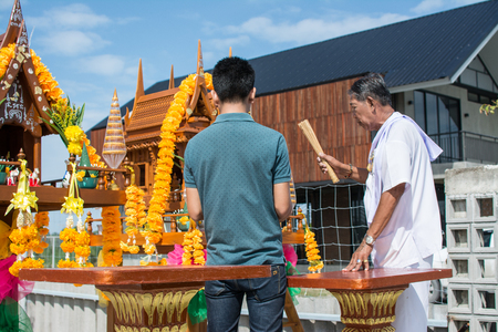 MUANG, SAMUTPRAKARN- SEPTEMBER 6 : Unidentified man is in worship the shrine of city pillar on September 6, 2018 at The shrine of city pillar, Muang,Samutprakarn, Thailand.