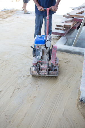 Worker use vibratory plates seals the base sand