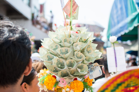 Bangnotes with decoration on money tree in Kathin ceremony, Kathin is one of the traditions of Buddhism every year. 報道画像