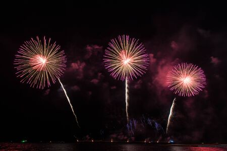 Beautiful firework display for celebration over the sea Фото со стока