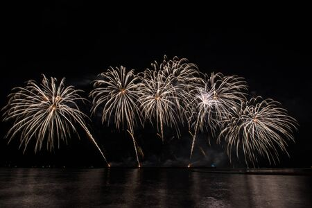 Beautiful firework display for celebration over the sea Stock Photo