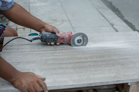 worker cutting  marble in construction site