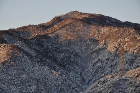 montañas nevadas: Montañas nevadas resplandor Foto de archivo