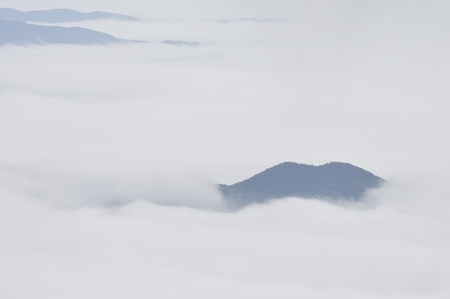 radiative: Mountain floating on a sea of clouds