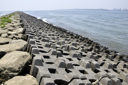 Coast of wave dissipating concrete blocks Stock Photo