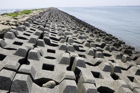 Coast of wave dissipating concrete blocks Stock fotó