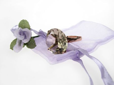 clothe: Ring with flower on a purple clothe case