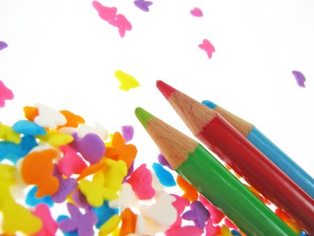 Close up to crayons on candies  photo