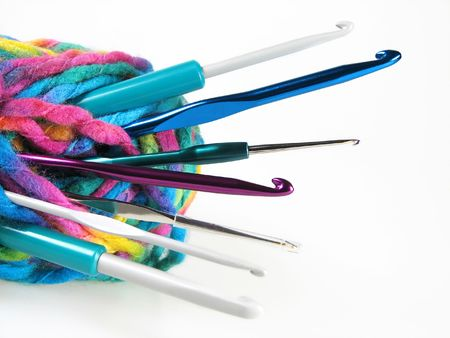 crochet: YARN WITH DIFFERENT SIZEF OF CROCHET HOOKS Stock Photo