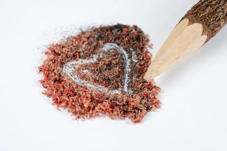Sharpened natural pencil and Heart shaped dust photo