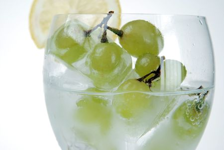 Frozen grapes in wine glass photo