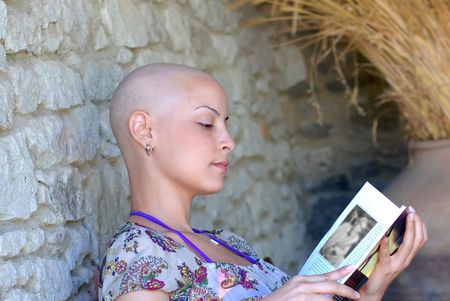 positive attitude: Cancer survivor while reading her book in positive attitude
