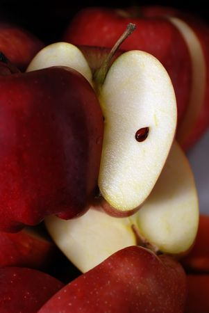 Organic Apple, close up shot of  half cut fresh apple  photo