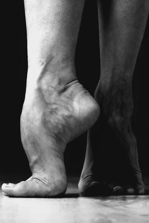 Contemporary dancer feet, black and white studio shot photo
