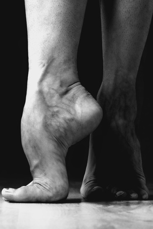 pointe: Contemporary dancer feet, black and white studio shot Stock Photo