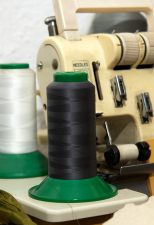 old spools: Sewing machine and thread spool