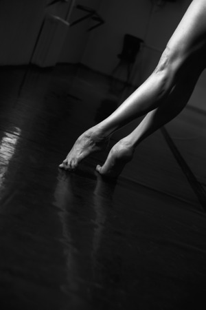 point and shoot: Ballet Dancer Point and Leg  , intentionally shoot at High ISO to give grainy and dramatic feel, selective noise reduction applied, Low Key, Black and White Studio Shot
