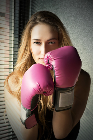 Young Blonde Boxing Woman with Pink Gloves