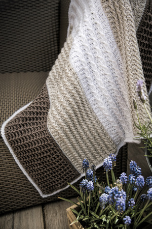 cable knit: Crochet, Cable Knit Baby Blanket in Cream White and Brown Colour on Sofa Stock Photo