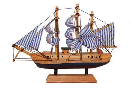 Wooden ship toy model, isolated on white background photo