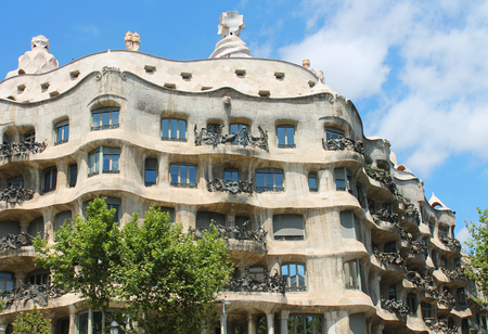 barcelona spain: Famous building was designed by Antoni Gaudi and is one of the most visited in the city.