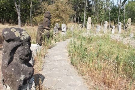 benevolent: Ancient sculpture made of stone in the forest on the island of Khortytsya Stock Photo