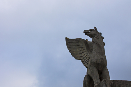 mythological: Mythological animal sculpture made of stone at the top Stock Photo