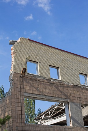 without windows: Ruins of a building and windows without glass in the Donbass in Ukraine Stock Photo