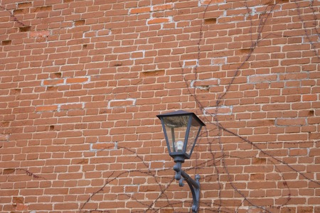 Public lighting on the wall of the church. Ukraine. Europe