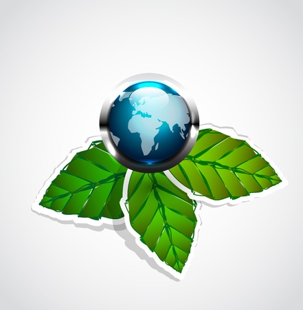 international recycle symbol: Vector glossy earth globe on green leaves