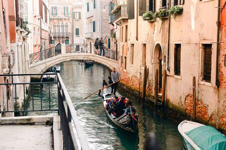 Gondola and Venice near the bridge