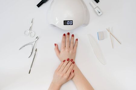 Tools for manicure hand in the hands Imagens