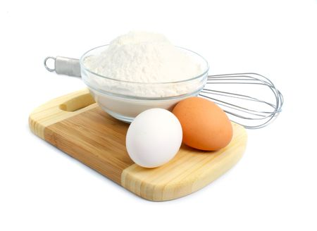 eggs and flour ingredients for dough preparation isolated over white background Stock Photo - 2685230