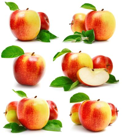 set red apple fruits with cut and green leaves isolated on white background photo