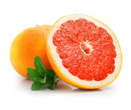 fresh grapefruit fruit with cut and green leaves isolated on white background photo