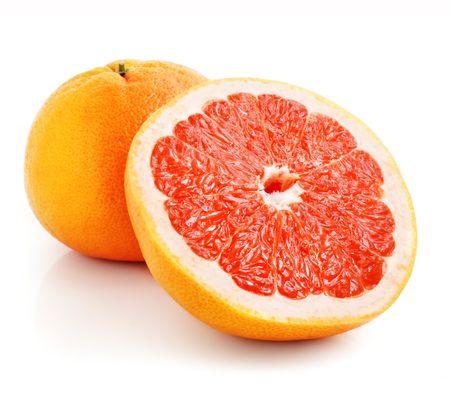 fresh grapefruit fruit with cut isolated on white background photo