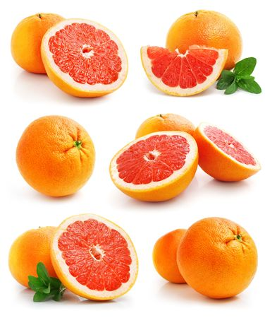 set of grapefruit fruits with cut and green leaves isolated on white background photo
