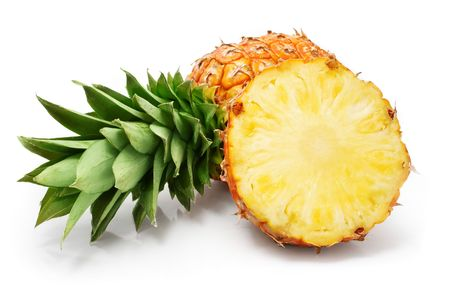 fresh pineapple fruits with cut and green leaves isolated on white background photo